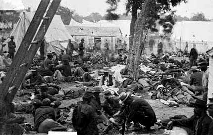 Union Army of the Potomac soldiers are treated in a field hospital at Savage Station